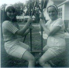 teenaged Ali and Mom on swing